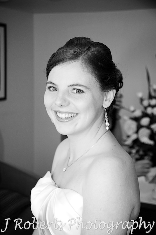 Smiling happy bride at Vibe Hotel - wedding photography sydney