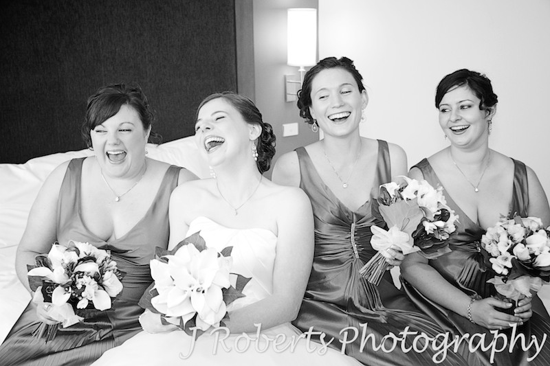 Bride laughing with her bridesmaids - wedding photography sydney