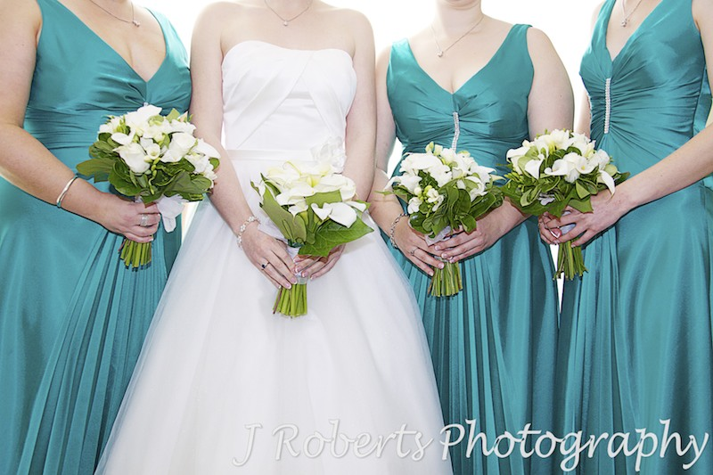 Bride and bridesmaids holding bouquets - wedding photography sydney