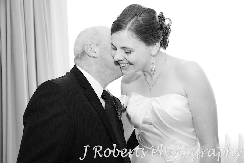 Bride giving her dad a hug - wedding photography sydney