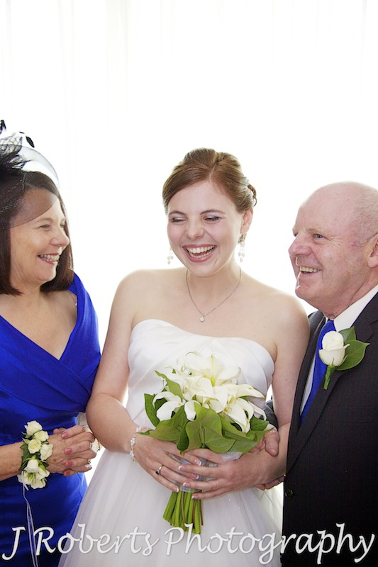 Bride laughing with her parents - wedding photography sydney