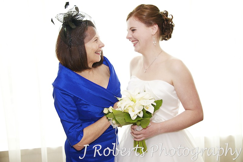Bride laughing with her mother before wedding - wedding photography sydney