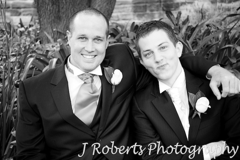 Groom pulling faces with groomsman - wedding photography sydney
