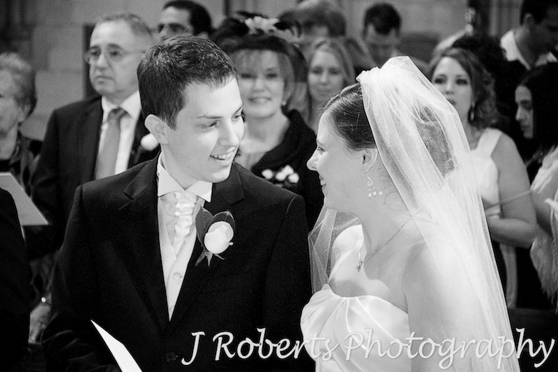 Couple sharing a moment during wedding ceremony at St Thomas' North Sydney - wedding photography sydney