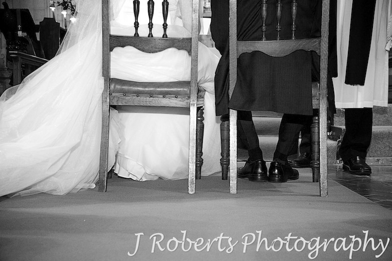 Couples feet during wedding sermon - wedding photography sydney