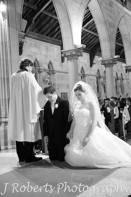 B&W of bride and groom praying - wedding photography sydney
