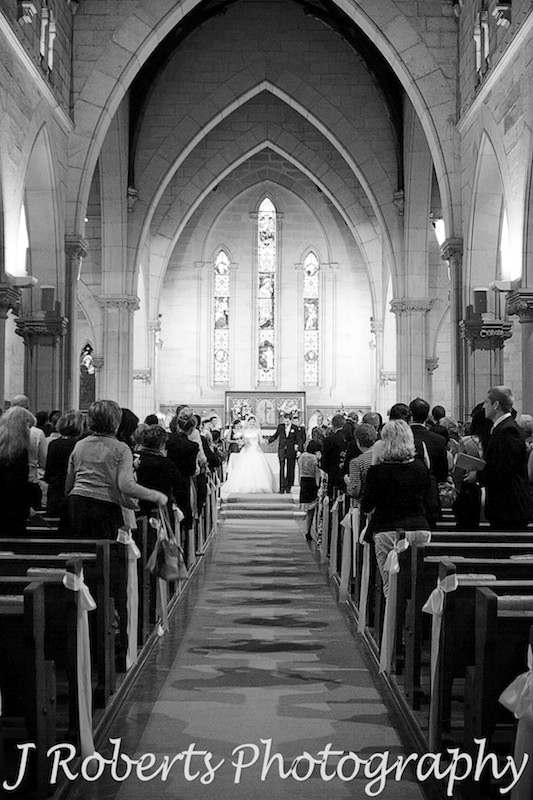 Married couple walk down the aisle at St Thomas' NOrth Sydney - wedding photography sydney