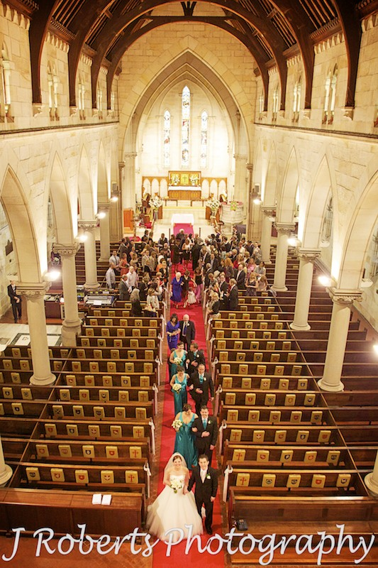 Bridal party walking down the aisle with an aerial view at St Thomas' North Sydney - wedding photography sydney