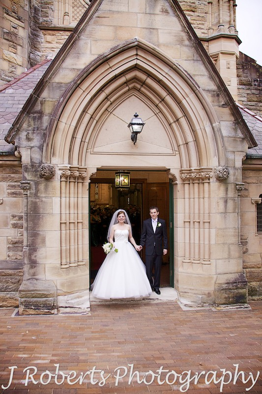 Bride and groom on the church steps at St Thomas' North Sydney - wedding photography sydney