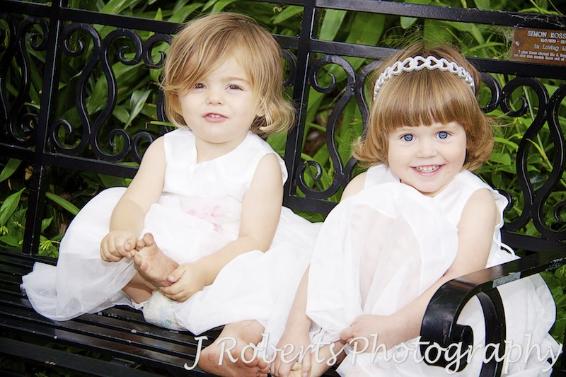 Little flowers girls on garden bench - wedding photography sydney