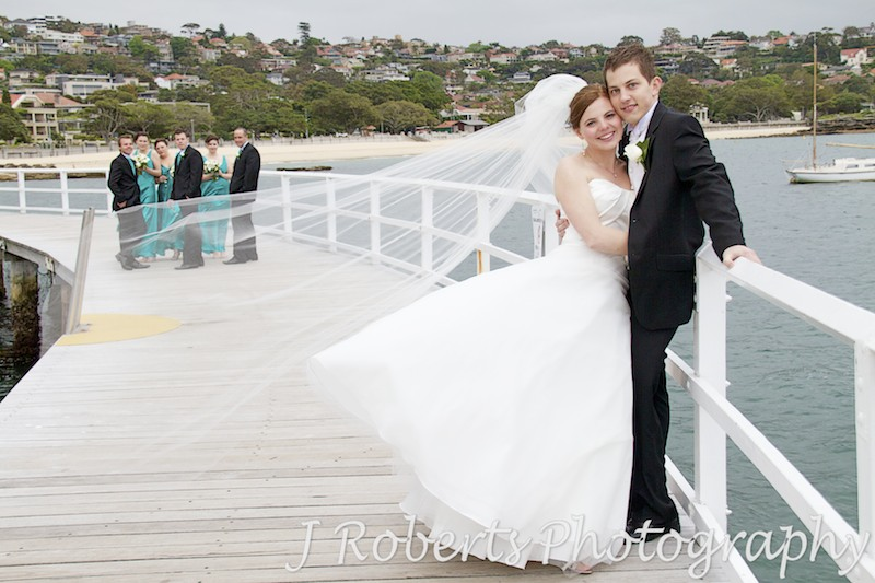 Bridal couple with fly away veil at balmoral baths - wedding photography sydney