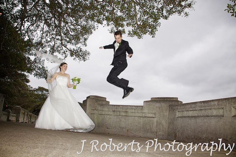 Groom jumping for joy - wedding photography sydney
