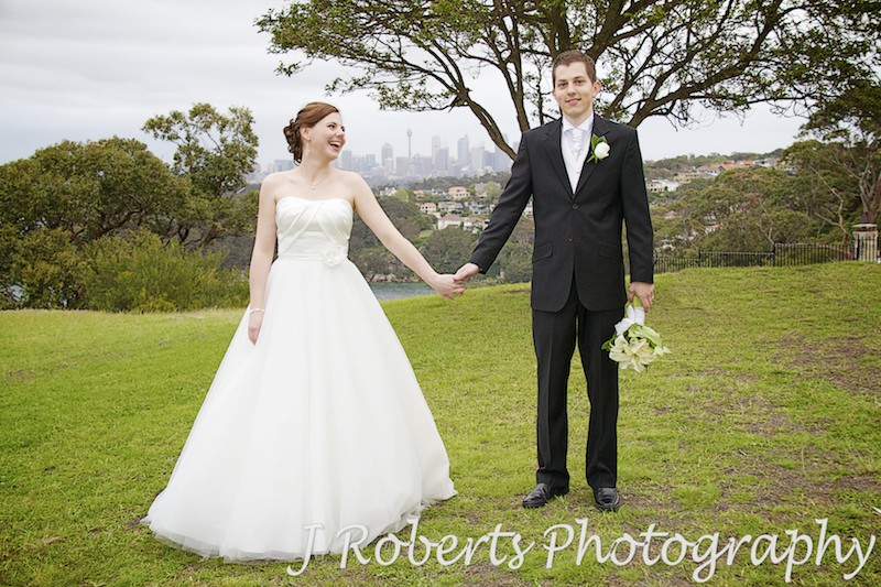 Bride and groom smiling at each other holding hands - wedding photography sydney