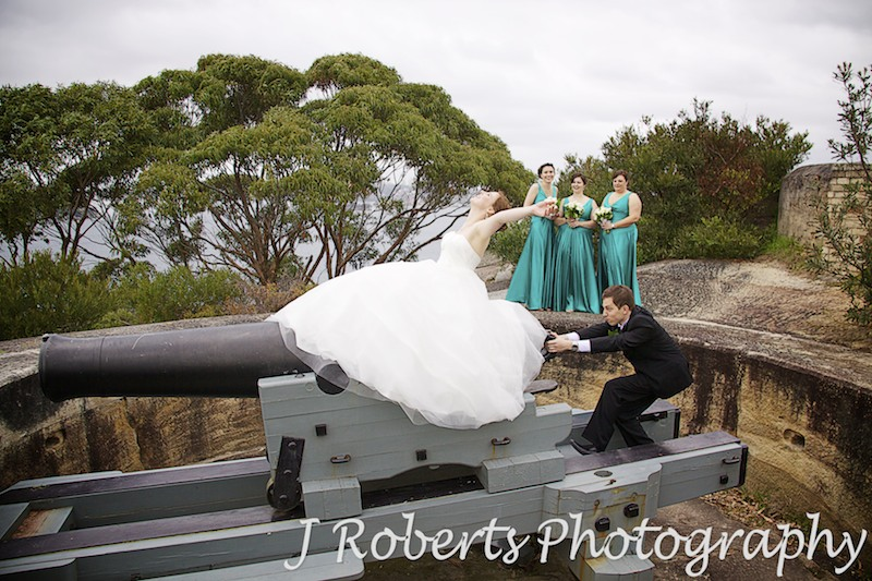Bride riding a cannon at Georges Headland Mosman - wedding photography sydney