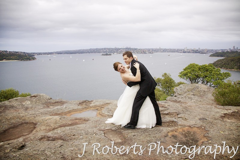 Bride and groom dipping on Georges Headland - wedding photography sydney
