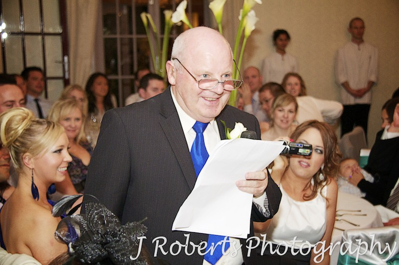 Father of the bride singing during wedding reception - wedding photography sydney