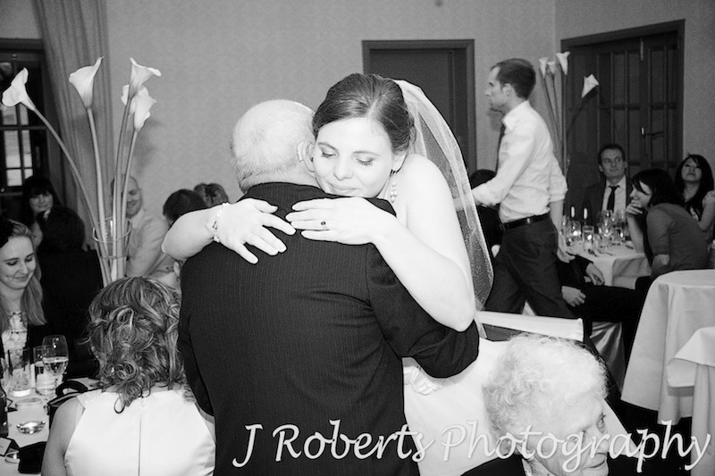 Bride hugging her father after wedding speech - wedding photography sydney