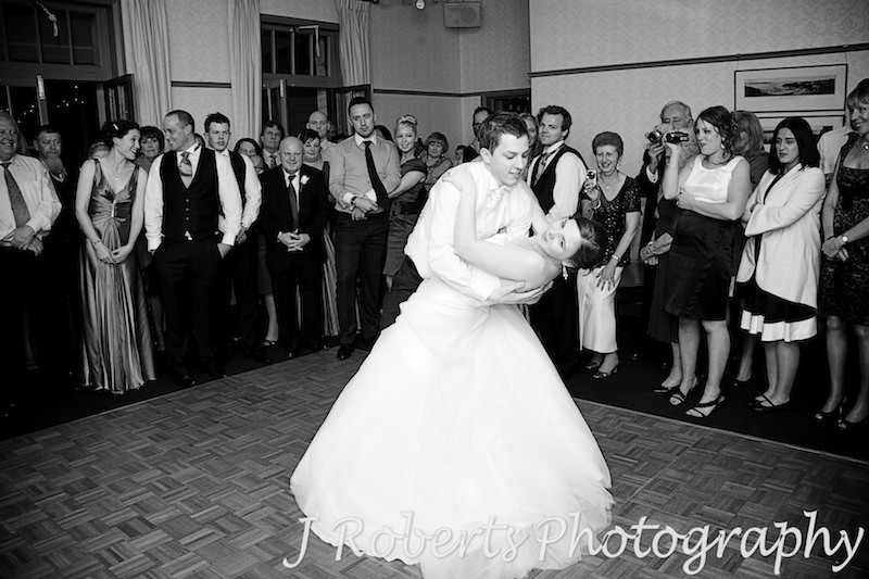 Bride being dipped by the groom during bridal waltz at The Tea Room Gunners' Barracks - wedding photography sydney