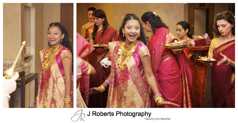 Bride about to enter the hindu marriage blessing - wedding photography sydney