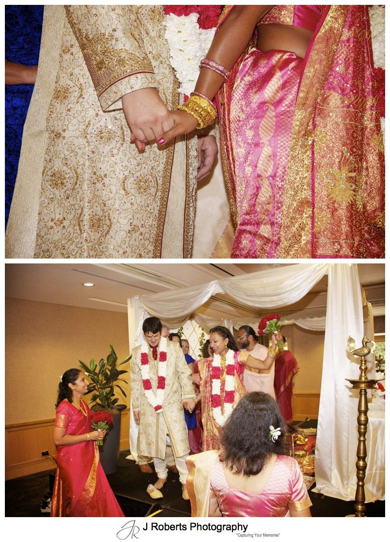 Bride and groom celebrating their hindu marriage blessing - wedding photography sydney