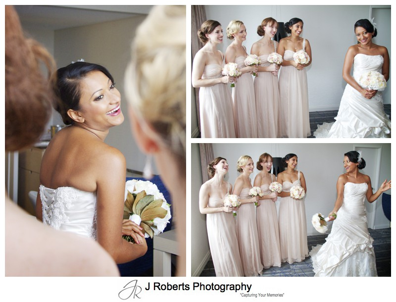 Bride laughing with bridesmaids in neutral colour dresses - wedding photography sydney