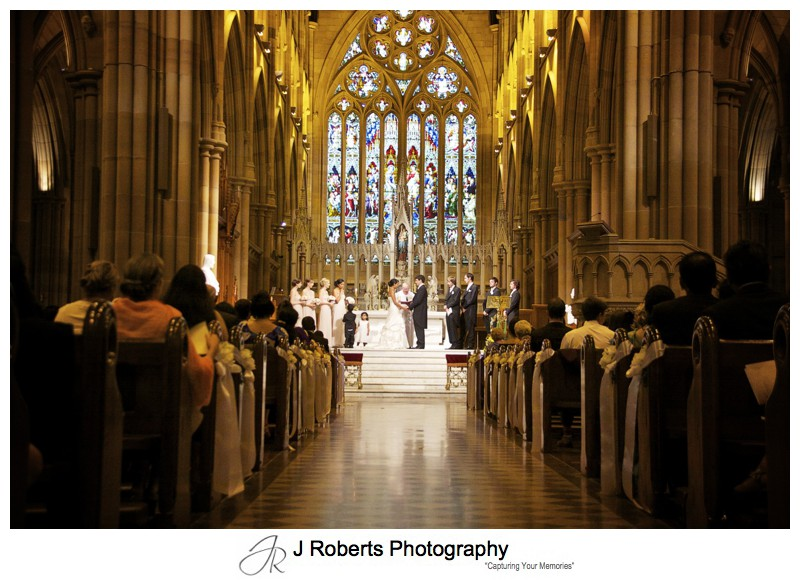 Bride and groom at the altar at St Mary's Cathedral - wedding photography sydney