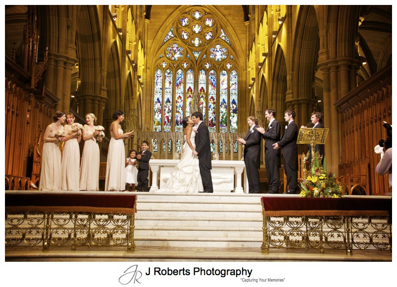 Bride and grooms kiss st Mary's Cathedral Sydney - wedding photography sydney