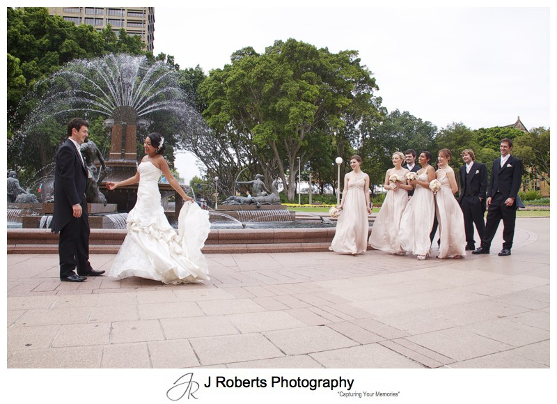 Bride and groom dancing in Hyde Park with Bridal party - wedding photography sydney