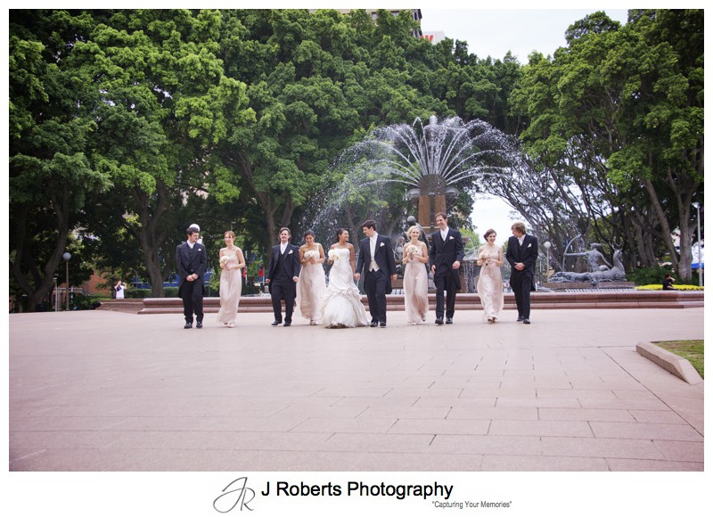 Bridal party walking through Hyde Park Sydney - wedding photography sydney
