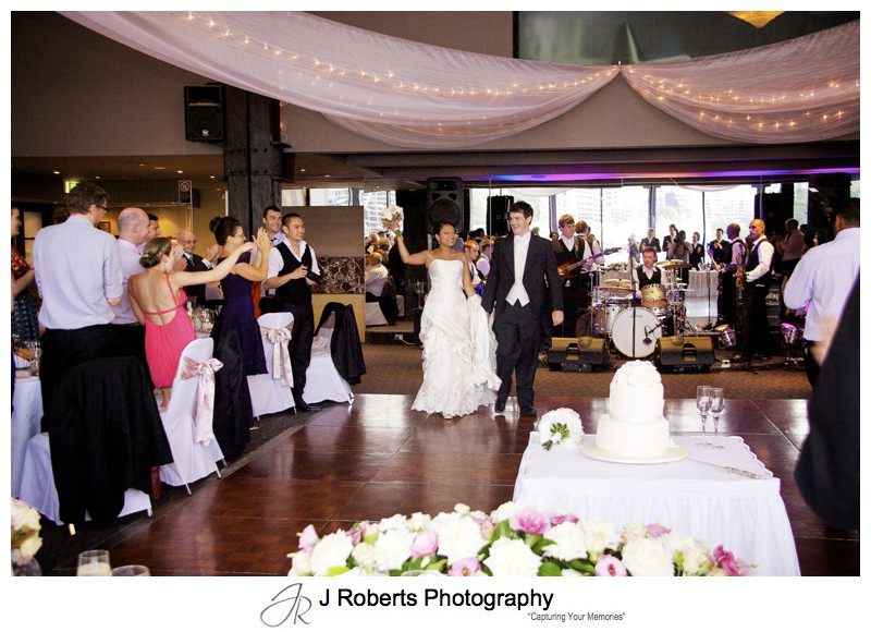 Bride and grooms entrance to wedding reception at Waters Edge - wedding photography sydney