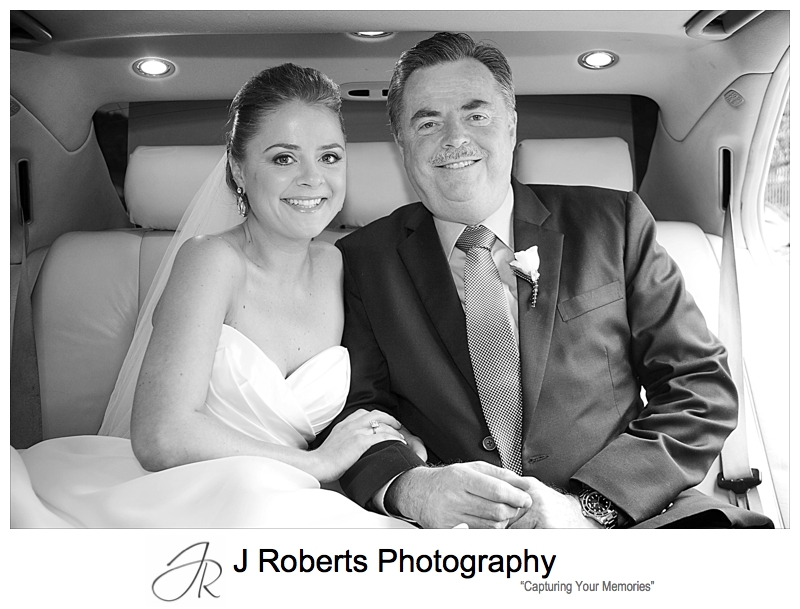 Bride and her father in the back of bridal car - wedding photography sydney