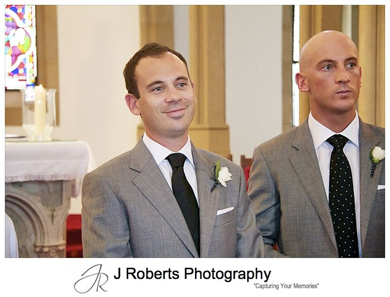 Groom smiling as he sees his bride - wedding photography sydney