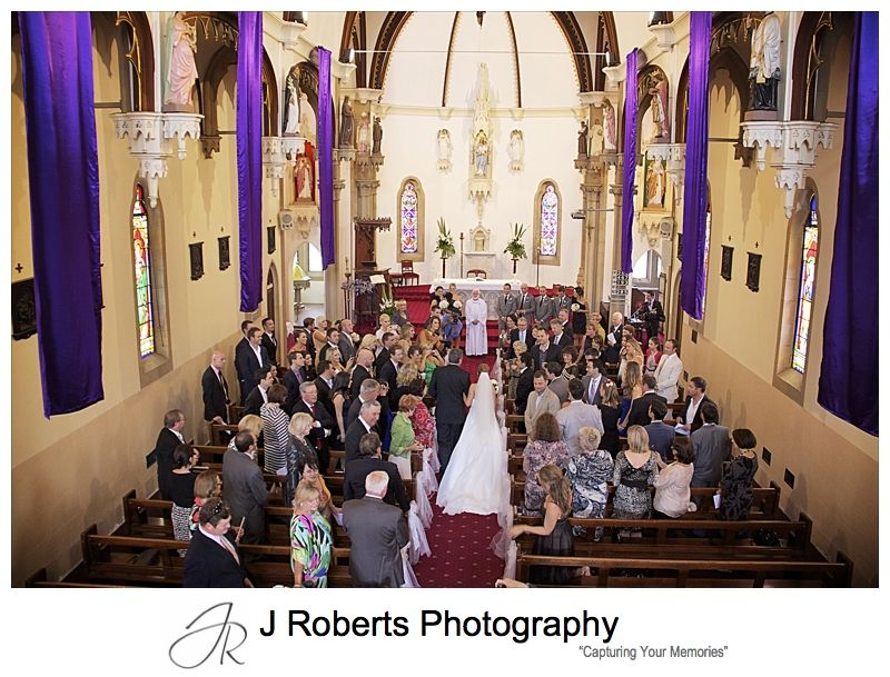 Bride walking to groom aerial view at Holy Name of Mary Hunters Hill - wedding photography sydney