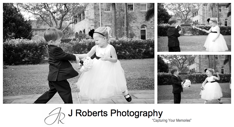 Flower girl and paige boy sword play outside church - wedding photography sydney