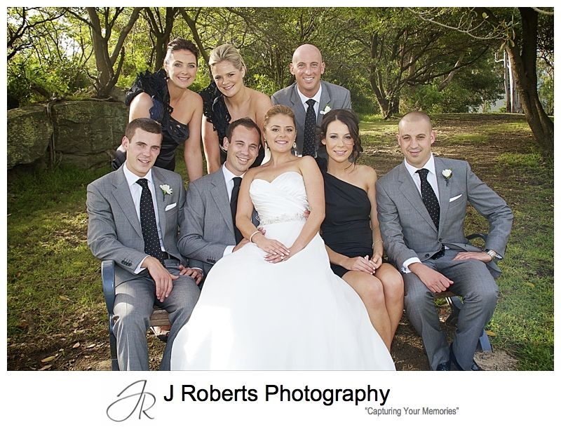 Bridal party gathered around the couple - wedding photography sydney