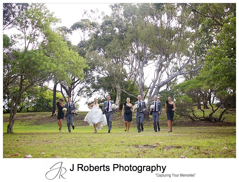 Bridal party having a running race - wedding photography sydney