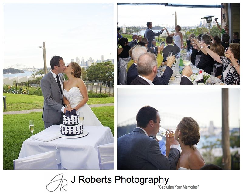 Couple cutting the cake and guests toasting - wedding photography sydney