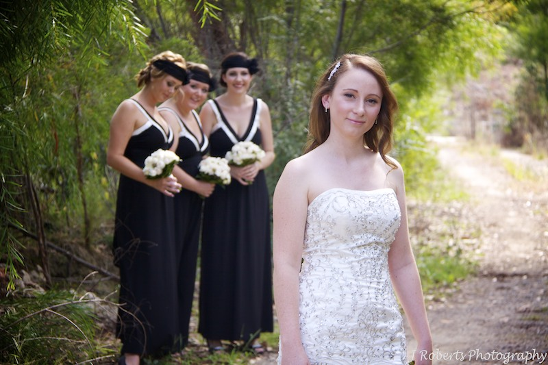 Bride and bridesmaids watching - wedding photography sydney