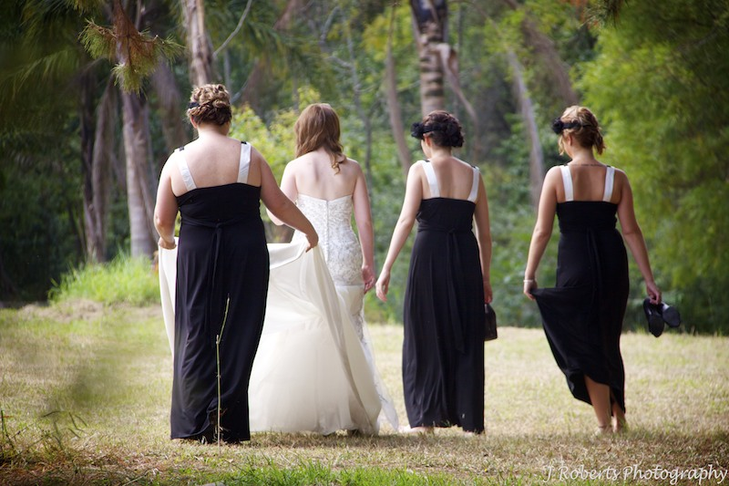 Bride walking with bridesmaids in bush setting - wedding photography sydney