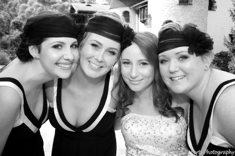 B&W bride and bridesmaids smiling - wedding photography sydney