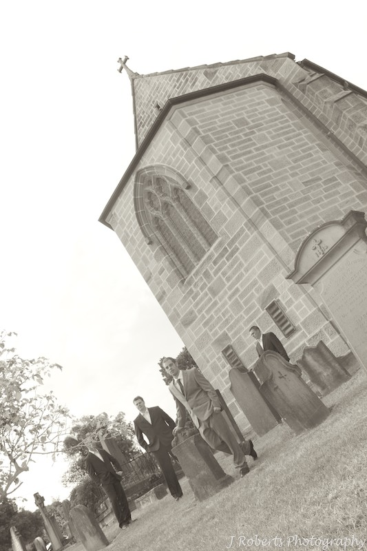 Groom with groomsmen outside church - wedding photography sydney