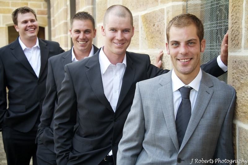 Grooms men leaning on church wall - wedding photography sydney