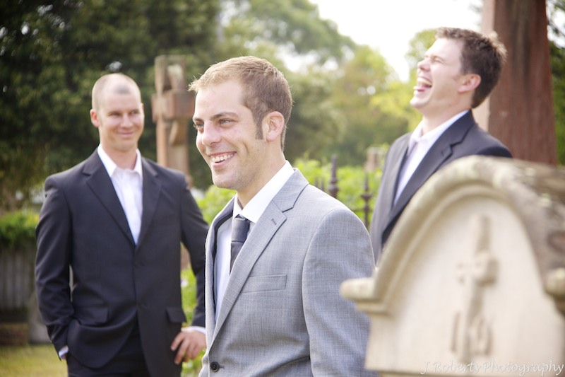 Groom boy band shot in graveyard at church - wedding photography sydney
