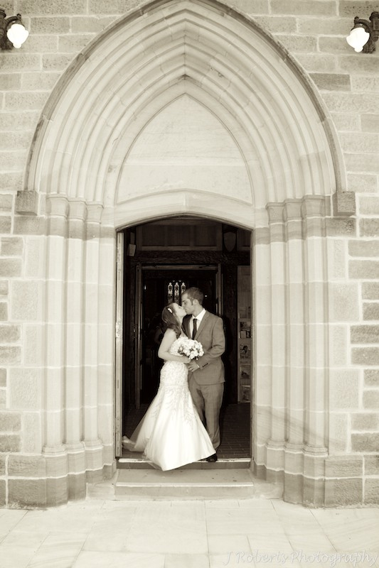 Bride & groom kissing outside church - wedding photography sydney