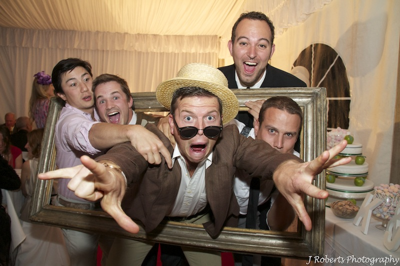 Photo booth fun at wedding reception - wedding photography