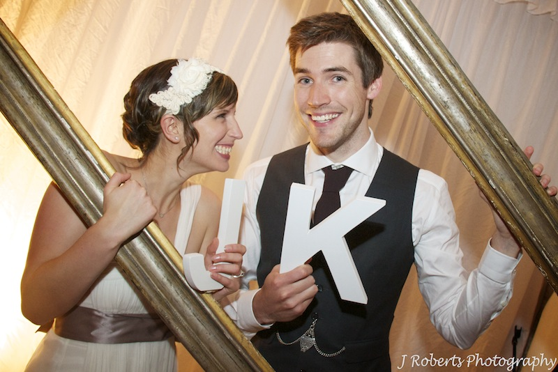 Bride and groom at photo booth - wedding photography