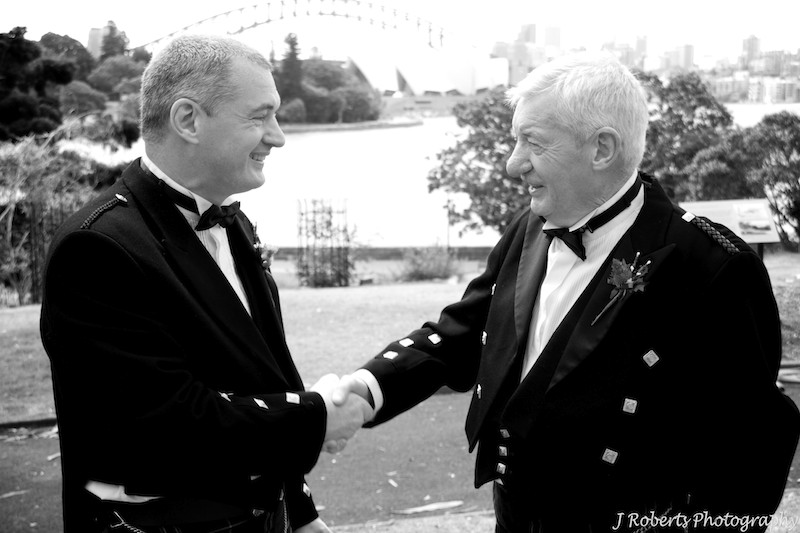 Groom and father shacking hands - wedding photography sydney
