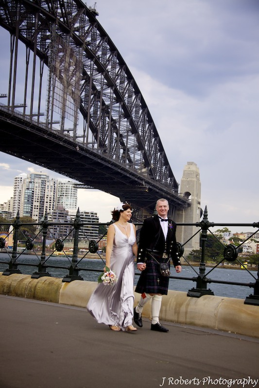 Bride and groom with Sydney Harbour Bridge - wedding photography sydney