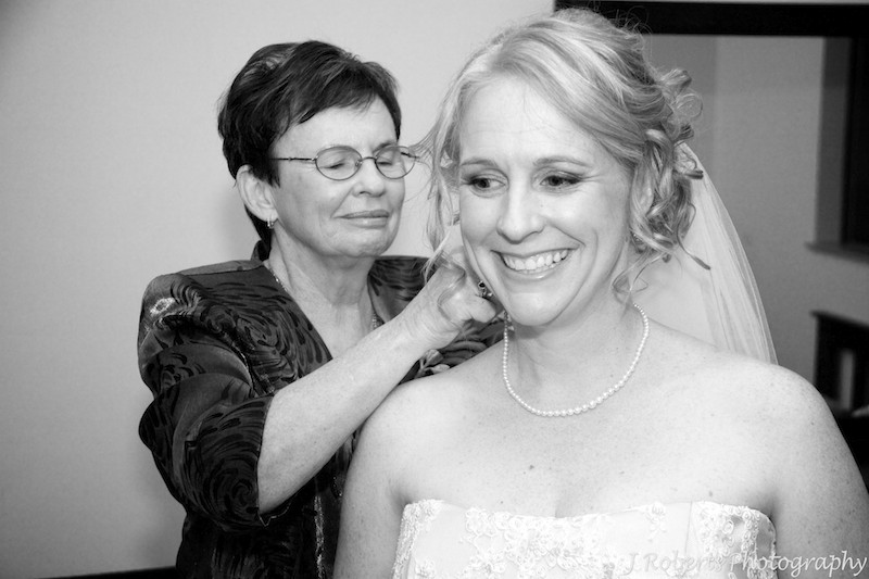 Mother putting necklace on bride - wedding photography sydney