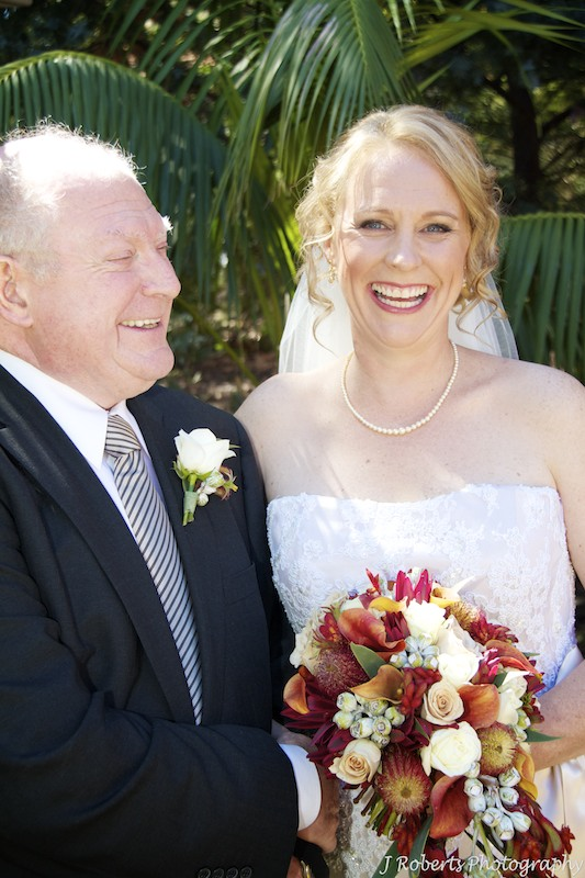 Bride and father laughing - wedding photography sydney